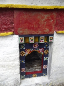 Prayer wheel turned by the waterfall